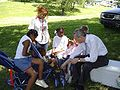 Dennis Moore talks with young people on Juneteenth.JPG