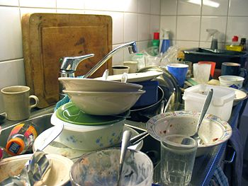 Unwashed dishes in a sink; an authentic situation.
