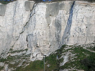 White Cliffs of Dover - The cliffs' multiple layers of flint match those seen across the channel at Cap Gris Nez, France, evidence of a land connection between England and France in prehistoric times.