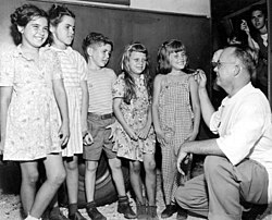 Dr. Drew H. Turner looking over a group of children's teeth in the Duval County dental trailer- Mayport, Florida (3311719318).jpg