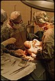 Dr. Howard Vogel, left, is assisted by his daughter, Dr. Ann Vogel, as they perform the last caesarean section of a... - nara - 558175.jpg
