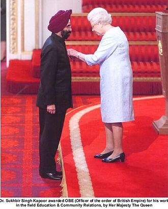 New Year Honours - Dr Kapoor receiving the OBE from the Queen