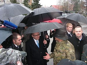 Operation Atlantic Resolve - Czech PM Bohuslav Sobotka (center) speaks with a member of the 2nd Cavalry Regiment during his visit to the convoy in Prague on 31 March 2015.