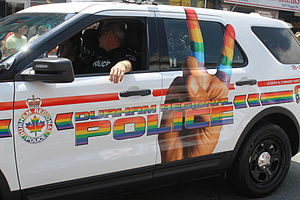 Durham Regional Police Service - Durham Regional Police vehicle and officers participating in a 2014 pride parade.