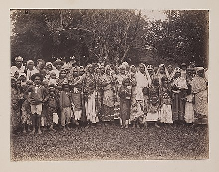 Indian indentured laborers in Trinidad and Tobago, c. 1890-1896. East Indian Women, Men and Children (13227675614).jpg