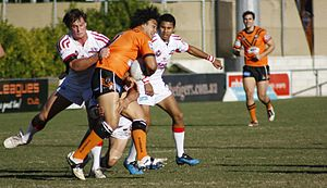 Queensland Cup - An Easts Tigers player tackled by the Redcliffe Dolphins at Langlands Park