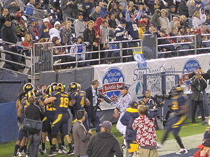 2009 Poinsettia Bowl - California players celebrate after Eddie Young's interception scored a touchdown to take a 14–0 lead