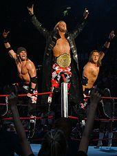 Edge alongside Curt Hawkins and Zack Ryder, three principal members of La Familia.