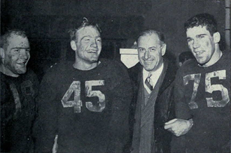 Bump Elliott - Elliot, brother Pete (No. 45), Fritz Crisler and Bruce Hilkene (No. 75) celebrate Big 9 championship after defeating Wisconsin.