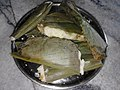 Enduri Pitha wrapped with turmeric leaf.jpg