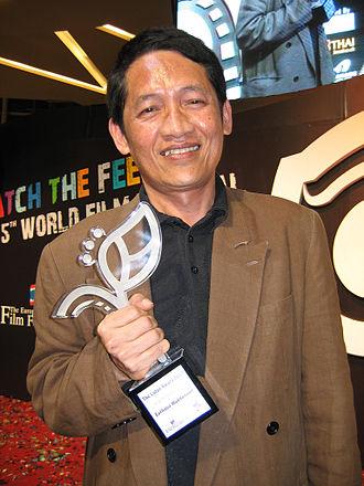 World Film Festival of Bangkok - Thai film director Euthana Mukdasanit with his Lotus Award for lifetime achievement at the 5th World Film Festival of Bangkok.