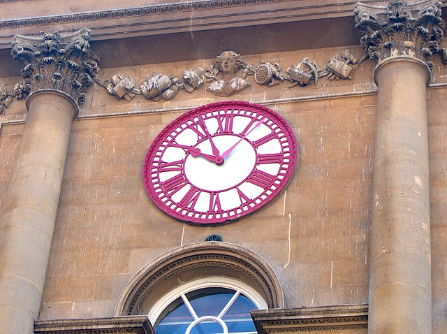 Clock on the Exchange, Bristol. Note the extra minute hand that denotes