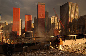 Rescue and recovery effort after the September 11 attacks on the World Trade Center - Firefighter watches debris removal at the World Trade Center on September 28th