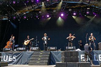 Denez Prigent - Denez and his musicians on biggest stage of Vieilles Charrues Festival in 2016.