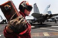 Flickr - Official U.S. Navy Imagery - A Sailor stands by to receive orders to chock an aircraft..jpg