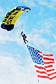 Flickr - Official U.S. Navy Imagery - Parachuter flies the U.S. flag..jpg