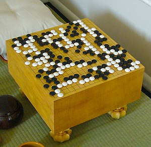 Go is played on a grid of black lines (usually 19×19). Game pieces