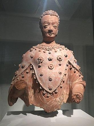Kapisa (city) - Statue of Buddha found in the monastery of Fondukistan, Gurband Valley, Parwan. VII century AD. Guimet Museum.