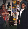 Forrest J. Ackerman, collector of movie memorabilia, with fan..jpg