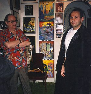 Film memorabilia - Collector Forrest J. Ackerman lets a fan pose in a cape worn by Bela Lugosi in footage used by director Ed Wood in Plan 9 From Outer Space