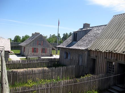 Recreated buildings inside the fort Fort Michilimackinac backyards.jpg
