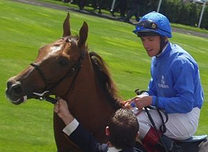 Frankie Dettori - Frankie Dettori in the parade ring at 'Glorious Goodwood' in August 2004