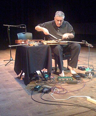 Fred Frith performing in Seattle in April 2009. FredFrith April2009 (cropped).jpg
