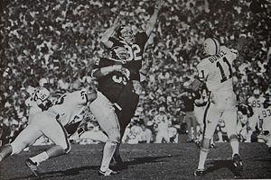 Fred Grambau - Grambau rushing Don Bunce in the 1972 Rose Bowl
