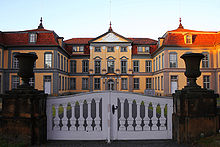 The symmetrical structure of Schloss Friedrichsthal, seen through the front gate to the property