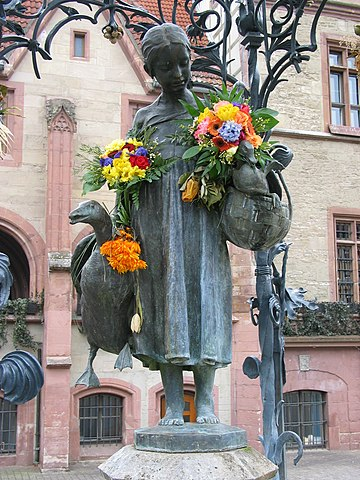 Gänseliesel fountain on the market square in Göttingen. Old townhall in the background. Image taken by Daniel Schwen on march 3rd 2006.