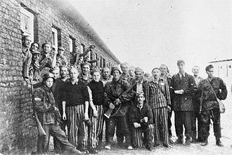"Gęsiówka - Jewish prisoners of Gęsiówka and Polish resistance fighters of the ""Zośka"" battalion of the Armia Krajowa after the liberation of the camp in August 1944"