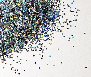 Glitter assortment of very small, flat, reflective particles
