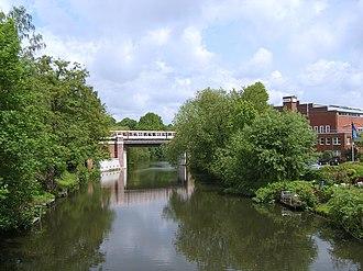 Winterhude - The channel Goldbekkanal with Hamburg U-Bahn bridge.