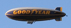 The Spirit of Goodyear has a distinctive yellow stripe under the logo.