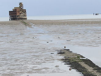 Isle of Grain - The Grain Tower 1855, and causeway seen at low tide 2008