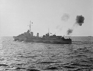 HMS Tartar (F43) - Salerno, 9 September 1943 (Operation Avalanche): HMS Tartar puts up an anti-aircraft barrage with her 4.7-inch AA guns to protect the invasion force from attack by enemy aircraft.