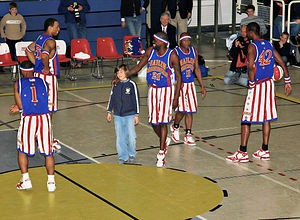 Harlem Globetrotters, are playing with a spect...
