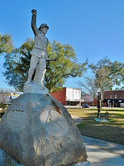 This statue of a WWI doughboy, with his arm outstretched, honors all of Headland's military dead. It stands at the center of Headland Public Square.