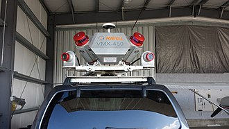 Laser scanning - A high speed mobile laser scanning system for 3D data acquisition mounted on an automobile.