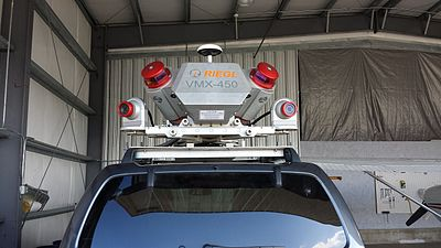 A high speed mobile laser scanning system for 3D data acquisition mounted on an automobile.