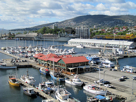 Hobart's Constitution Dock is the arrival point for the fleet after they have completed the race, and usually witnesses scenes of celebration by many yachtsmen during the new year festivities. Hobart Wharfchancellor.jpg