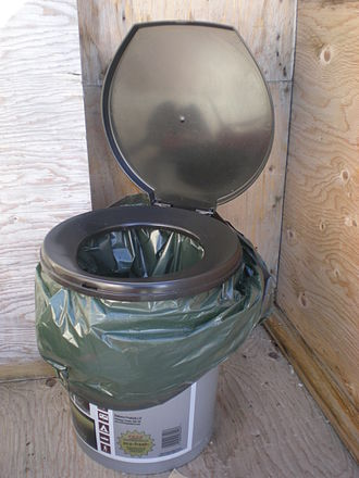 Bucket toilet - A plastic bucket fitted with a toilet seat for comfort and a lid and plastic bag for waste containment