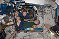 ISS-20 Robert Thirsk exercises using the aRED in the Unity node Roman Romanenko assists.jpg