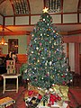 Image of Reproduction Christmas Tree in Den at TENHP for holiday exhibit in 2013 (b94e754f-01f5-4f60-a39a-01578304f59e).jpg