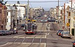 Inbound N Judah train crossing 18th Street, March 2001.jpg