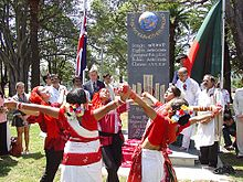 Outdoor ceremony, with girls in red-and-white costumes dancing