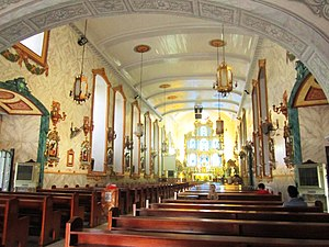San Pedro Macati Church - The Poblacion Church houses an altar with its carved retablo.