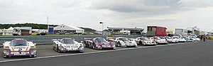 Jaguar XJR sportscars - A grouping of various XJRs, from left to right: An XJR-9, three XJR-12s, another XJR-9, two XJR-11s, an XJR-10, an XJR-6, and an XJR-5
