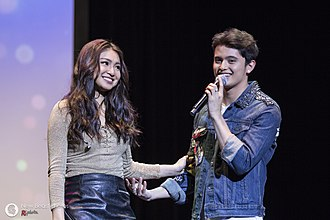 """Love team - The Filipino on-screen couple """"JaDine"""", formed by James Reid (right) and Nadine Lustre (left), both of whom are a romantic couple in real life, is an example of a love team."""