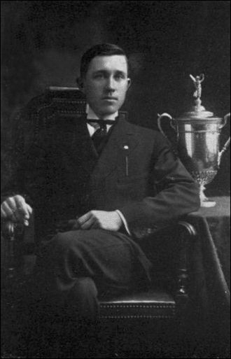 John McDermott (golfer) - Defending champion McDermott with the U.S. Open trophy in 1913